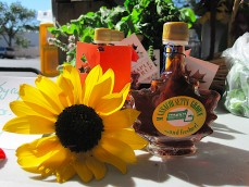 We sell maple syrup in souvenir bottles at local farmers' markets!