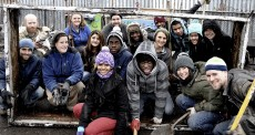 18 people came out in the snow to help rearrange raised beds on the lot!